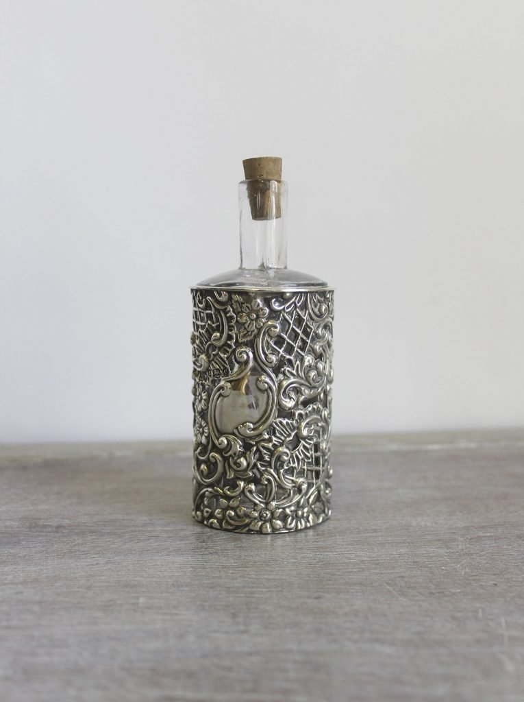 silver cased perfume bottle one